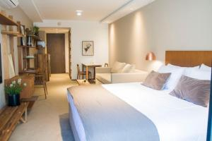A bed or beds in a room at AQ Tailored Suites