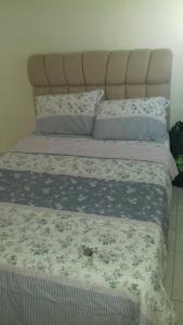 Cama o camas de una habitación en Expedito acomodações