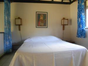 Cama ou camas em um quarto em Bungalows Tipaniers Iti