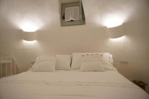 Letto o letti in una camera di Trullo Essenza-Trulli Antì Charme & Relax
