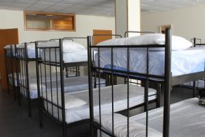 A bunk bed or bunk beds in a room at Albergue Ferramenteiro