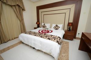 Cama ou camas em um quarto em Hotelier Al Sulaymaniyh