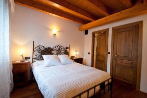 Cama o camas de una habitación en Ca l'Andreu
