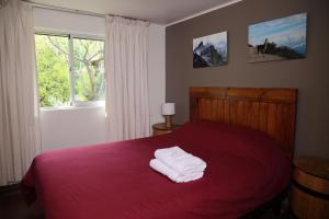 A bed or beds in a room at Casa Suiza