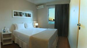 A bed or beds in a room at Hotel Eldorado Flat