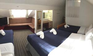 A bed or beds in a room at The Talbot Hotel