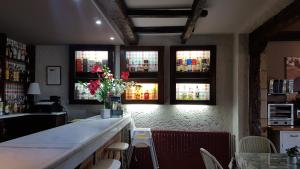 The lounge or bar area at Hotel Colegiata
