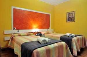 A bed or beds in a room at Hostal Europa