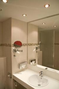 A bathroom at Grand Hotel Dream Main City Center