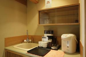 Een keuken of kitchenette bij Sakan