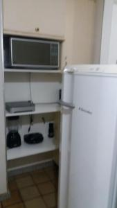 A kitchen or kitchenette at Ondina Apart Hotel Residence