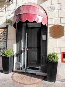 Фасад или вход в Hotel Anfiteatro Flavio