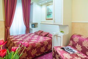 Кровать или кровати в номере Hotel Anfiteatro Flavio