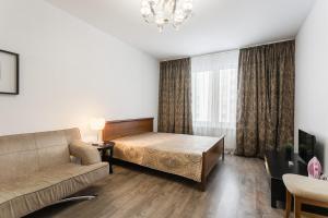 Кровать или кровати в номере Апартаменты София