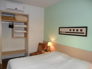 Cama ou camas em um quarto em Hotel Sinuelo