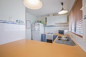A kitchen or kitchenette at Woolamai Family Retreat