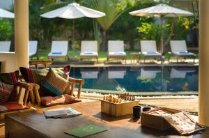 Der Swimmingpool an oder in der Nähe von Navutu Dreams Resort & Wellness Retreat
