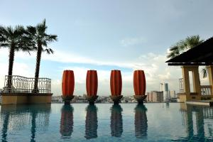 The swimming pool at or near The Grand Fourwings Convention Hotel Bangkok