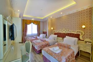 A bed or beds in a room at Nayla Palace Hotel-Special Category