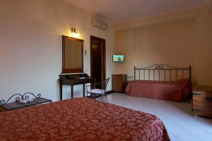 Letto o letti in una camera di Hotel A Pinnata