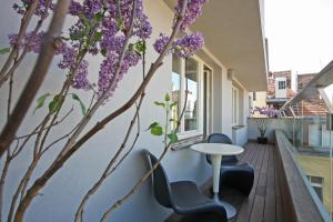 A balcony or terrace at The Emblem Hotel