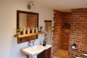 Ein Badezimmer in der Unterkunft Haus62