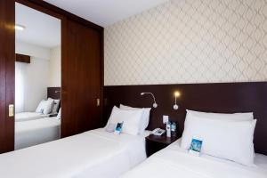 A bed or beds in a room at Mercure Sao Paulo JK