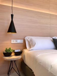 Un ou plusieurs lits dans un hébergement de l'établissement Inside Bilbao Apartments