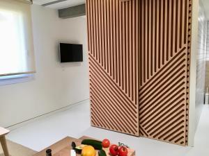 Télévision ou salle de divertissement dans l'établissement Inside Bilbao Apartments