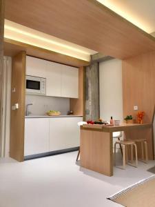 Cuisine ou kitchenette dans l'établissement Inside Bilbao Apartments