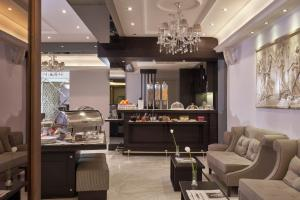 A restaurant or other place to eat at Ava Hotel and Suites