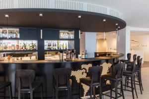 The lounge or bar area at Hotel Global Inn