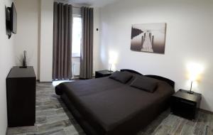 Кровать или кровати в номере Апартаменты Аибга