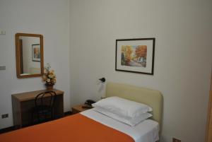 """Кровать или кровати в номере Albergo """"da Mario"""""""