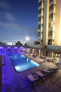 The swimming pool at or near Chelsea Plaza Hotel