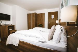 Кровать или кровати в номере Hotel Römerhof