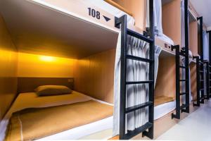 A bed or beds in a room at 18 Coins Cafe & Hostel
