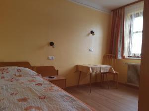 Ein Bett oder Betten in einem Zimmer der Unterkunft Gasthof Zentral