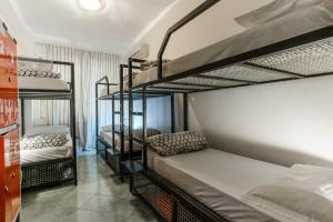 A bunk bed or bunk beds in a room at Hostel of the Sun