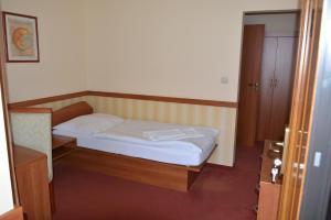 Posteľ alebo postele v izbe v ubytovaní Penzion na Potočnej