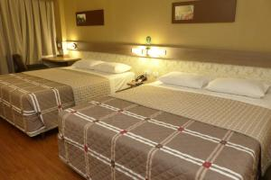 A bed or beds in a room at Hotel 10 Palmas