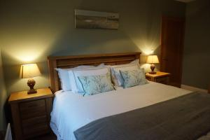 A bed or beds in a room at Dromore Court