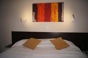 A bed or beds in a room at Hotel Aire de Patagonia