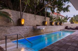 The swimming pool at or near Mantis No5 Boutique Art Hotel