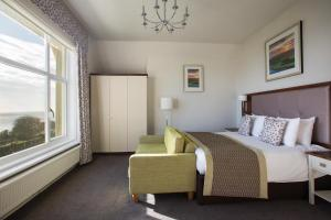 A bed or beds in a room at Hydro Hotel