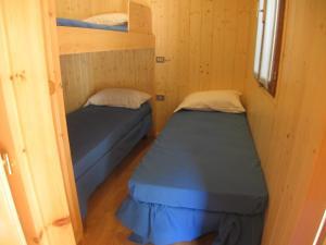 Ein Bett oder Betten in einem Zimmer der Unterkunft Campeggio Valle Gesso