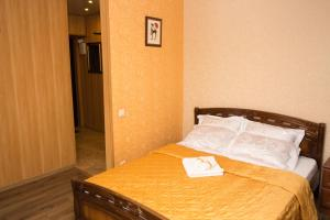 A bed or beds in a room at Апартаменты Филя