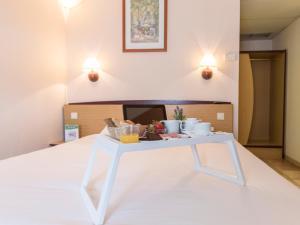 Uma cama ou camas num quarto em Campanile Lisboa Sud - Setubal