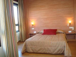 Cama o camas de una habitación en Hotel Castilla