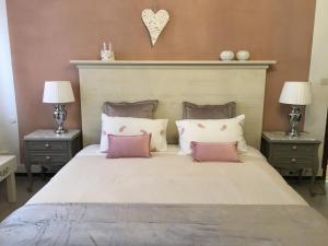 A bed or beds in a room at La Casita de Las Palmas